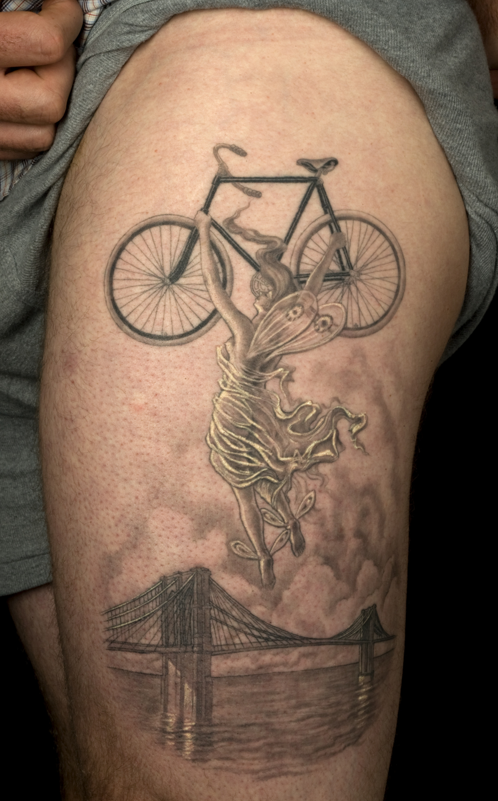Fairy Lifting Cycle Tattoo On Biceps