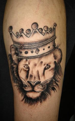 Lion Crown Tattoo On Muscles