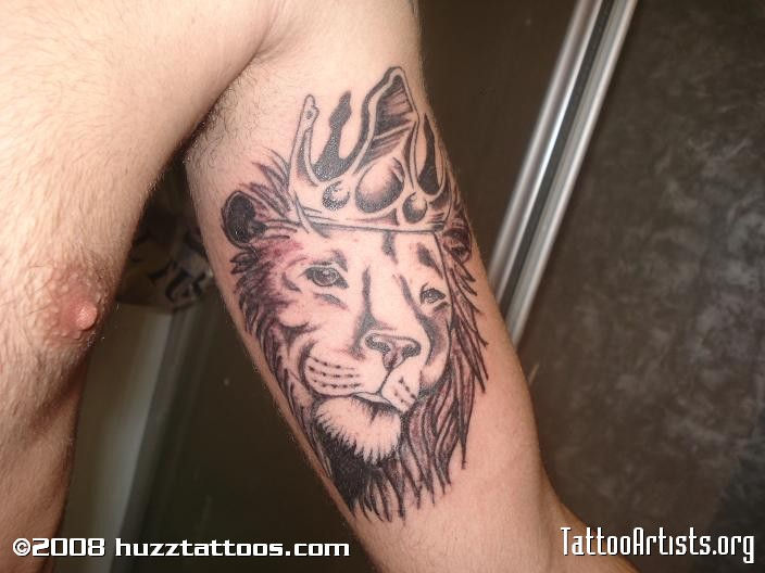 Lion With Crown Tattoo On Biceps