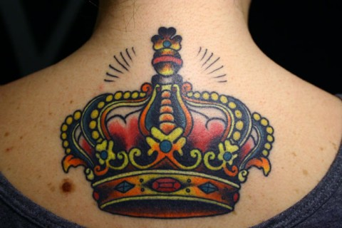 Lovely Crown Tattoo On Upper Back