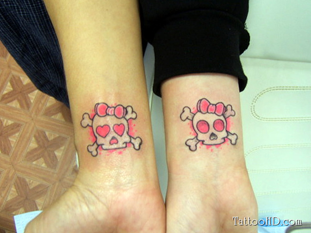 Matching Skull Tattoo On Wrists For Couples