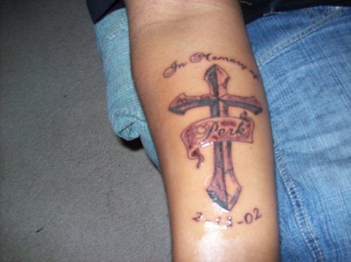 Memorable Cross Tattoo On Forearm