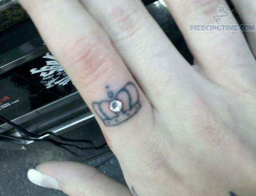 Piercing For Fingers With Micro Dermals n Crown Tattoo Design
