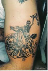 Skeleton Cowboy Tattoo On Muscles