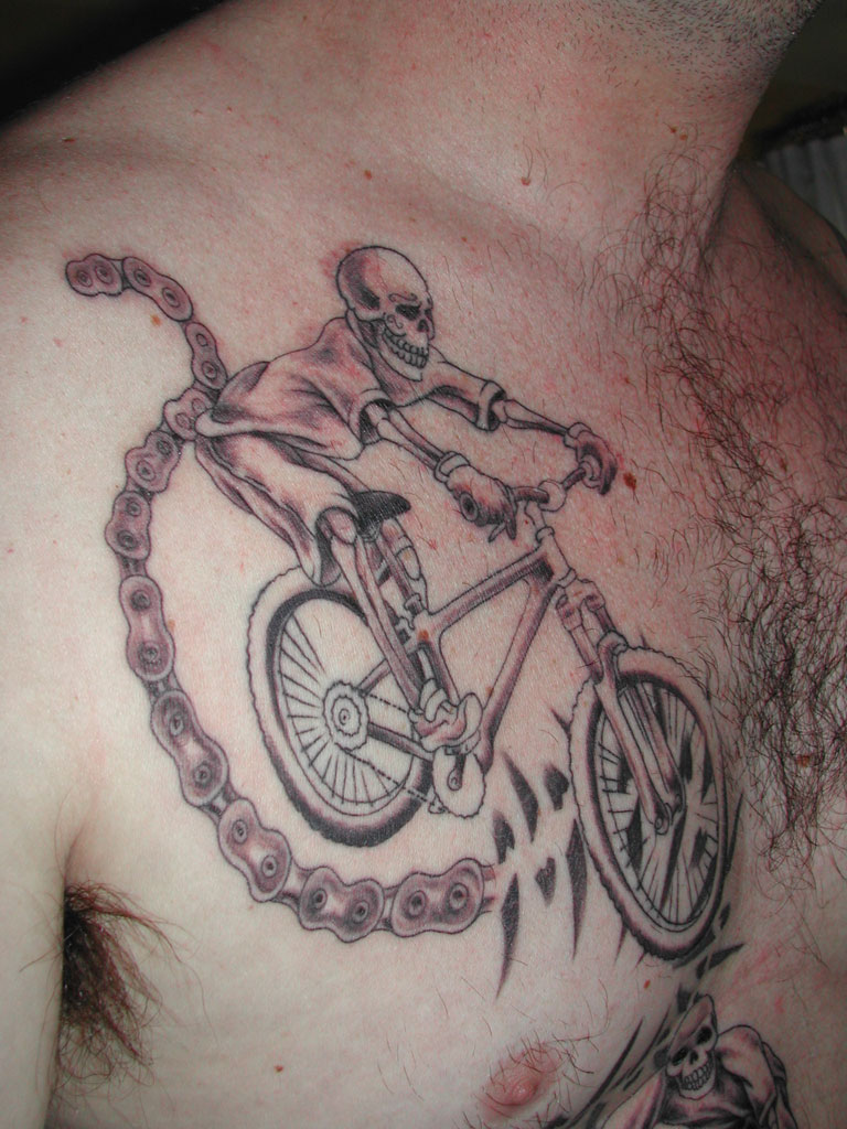 Skull Cycle Tattoo On Chest For Men