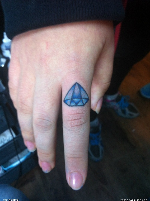 Small Blue Diamond Tattoo On Finger