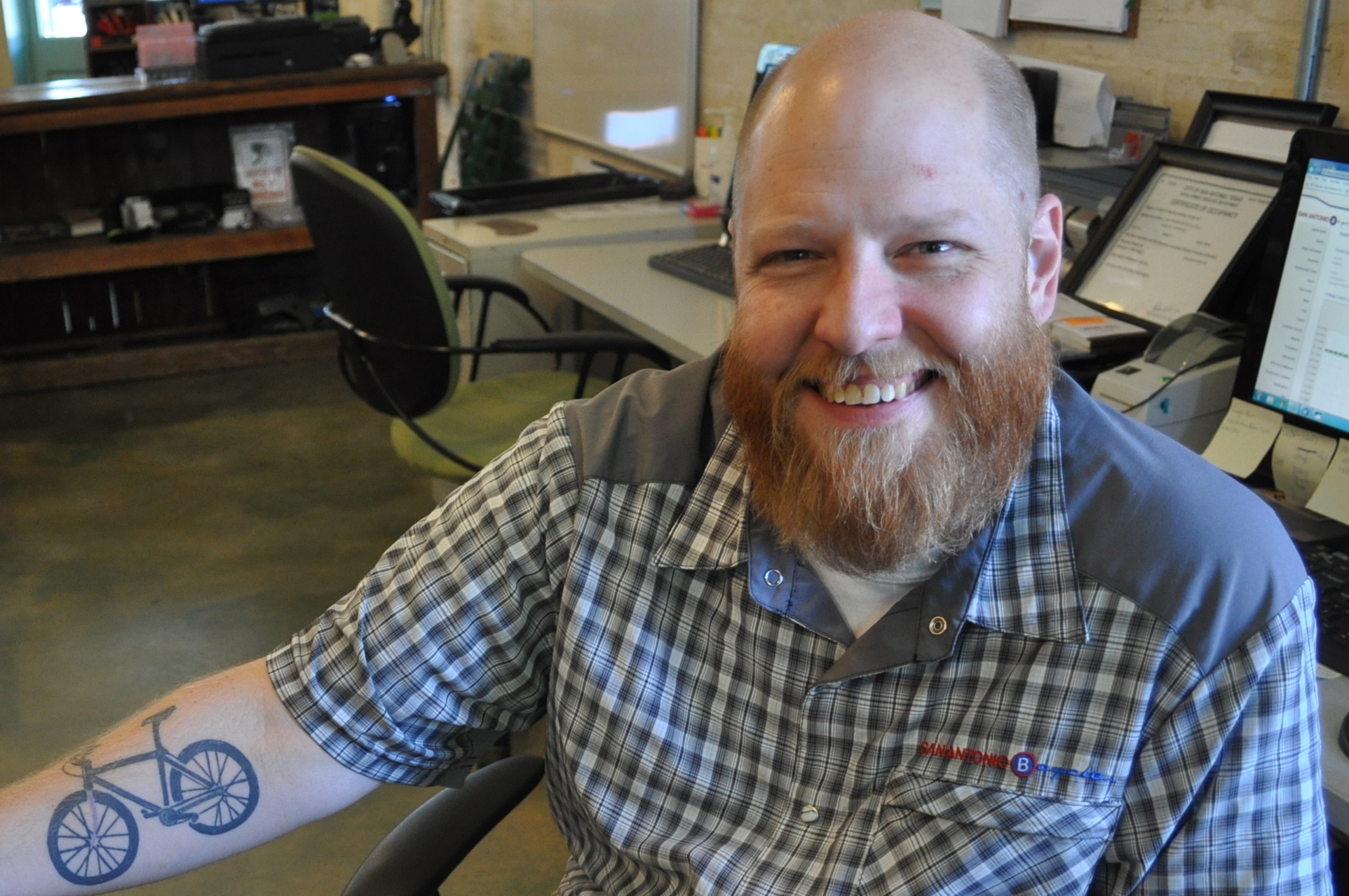 Smiling Man With Cycle Tattoo On Arm