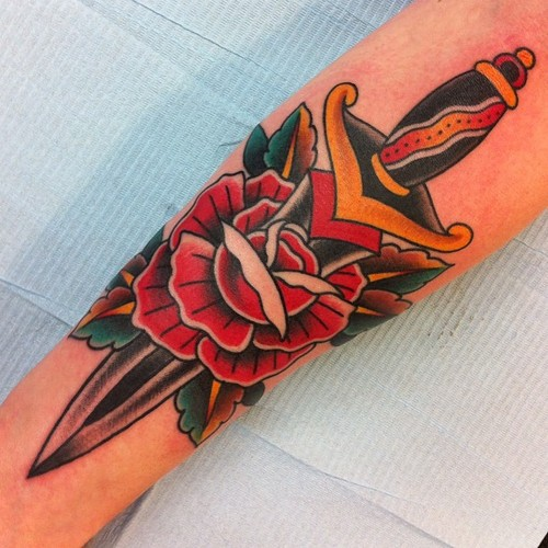 Traditional Rose Dagger Tattoo On Arm