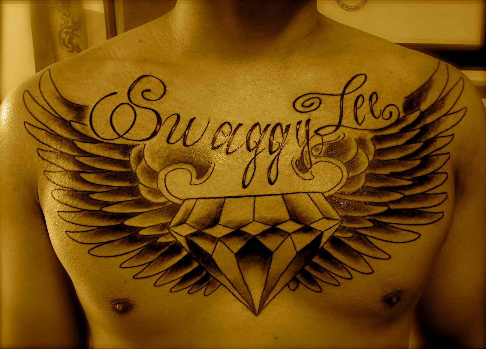 Wings Diamond Tattoo On Chest