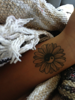 Yin Yang Daisy Flower Tattoo On Wrist