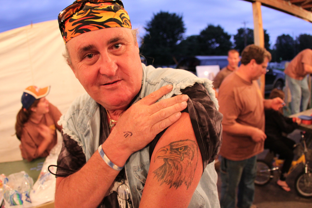 An Old Boy Showing Crying Eagle Tattoo On Biceps