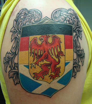Attractive Family Crest Tattoo On Shoulder