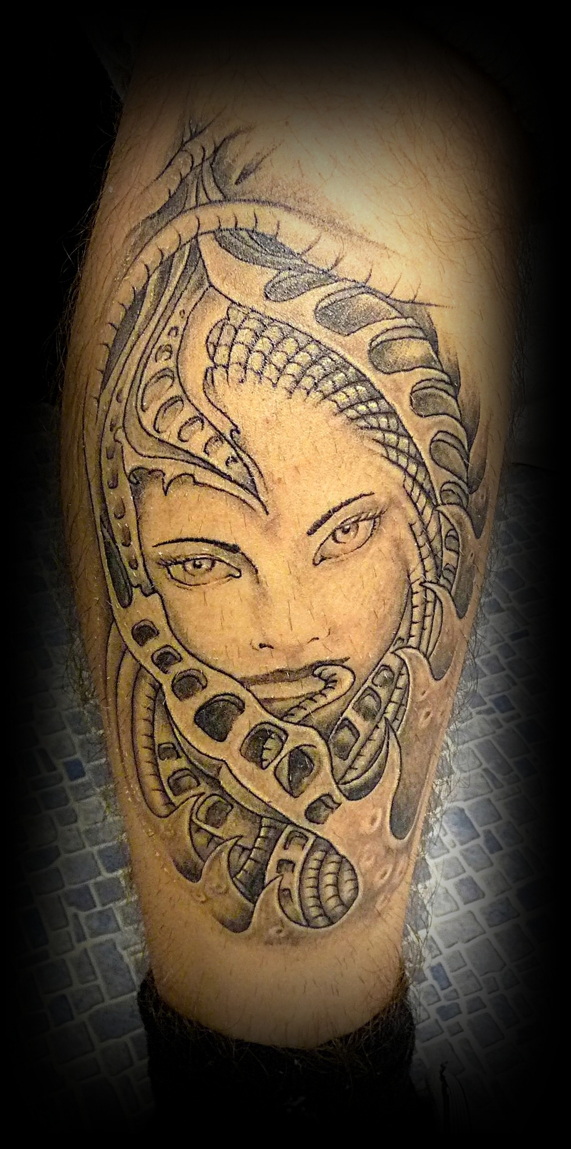 Biomechanical Woman Face Tattoo On Leg