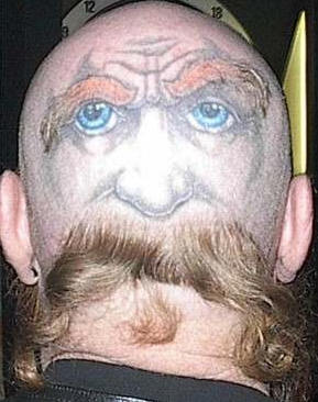 Blue Eyes Face Tattoo On Back Head