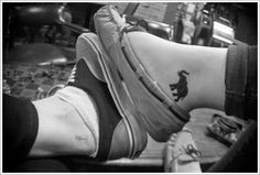 Cute Black Ink Elephant Tattoo On Foot