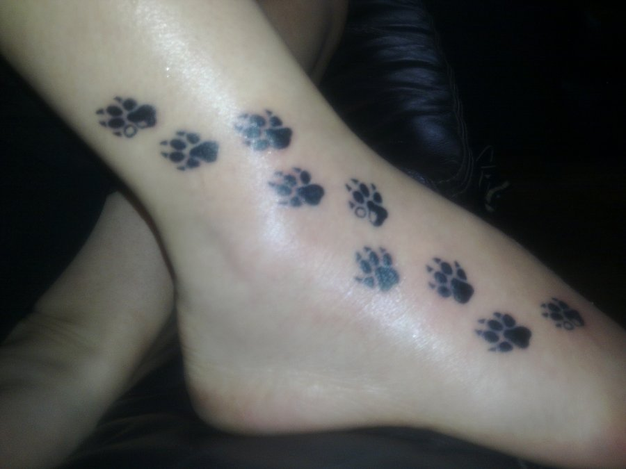 Dog Paw Prints Tattoo On Foot