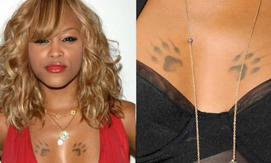 Dog Paws Tattoo On Celebrity Chest