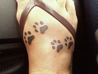 Dog Paws Tattoo On Foot