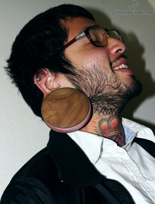 Ear Stretching n Crown Tattoo On Neck