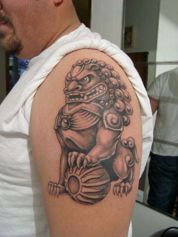 Foo Dog Peony Chest Tattoo On Shoulder