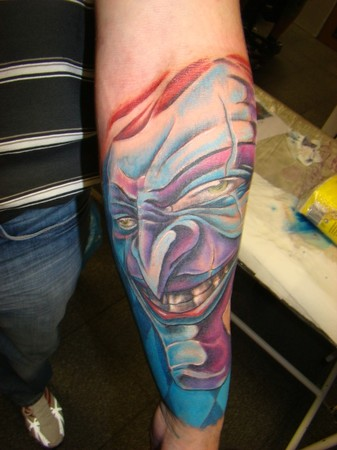 Joker Face Tattoo On Lower Arm