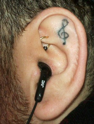 Music Note Tattoo In Ear