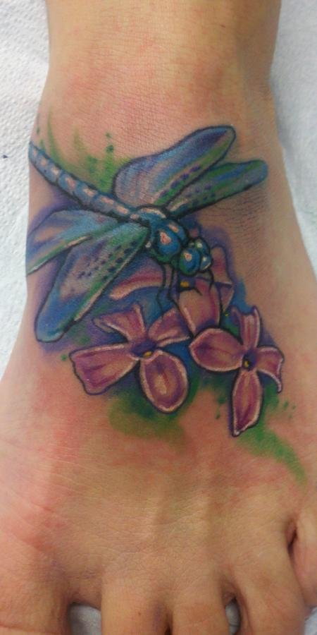 Nice dragonfly tattoo on foot