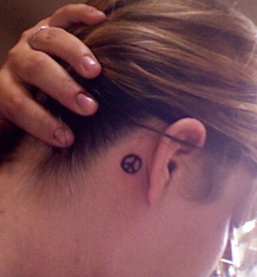 Peace Sign Tattoo Below Ear