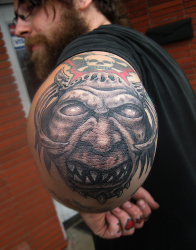 Scary Face Tattoo On Left Elbow
