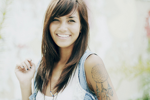 Smiling Girl With Dream Catcher Tattoo On Upper  Arm