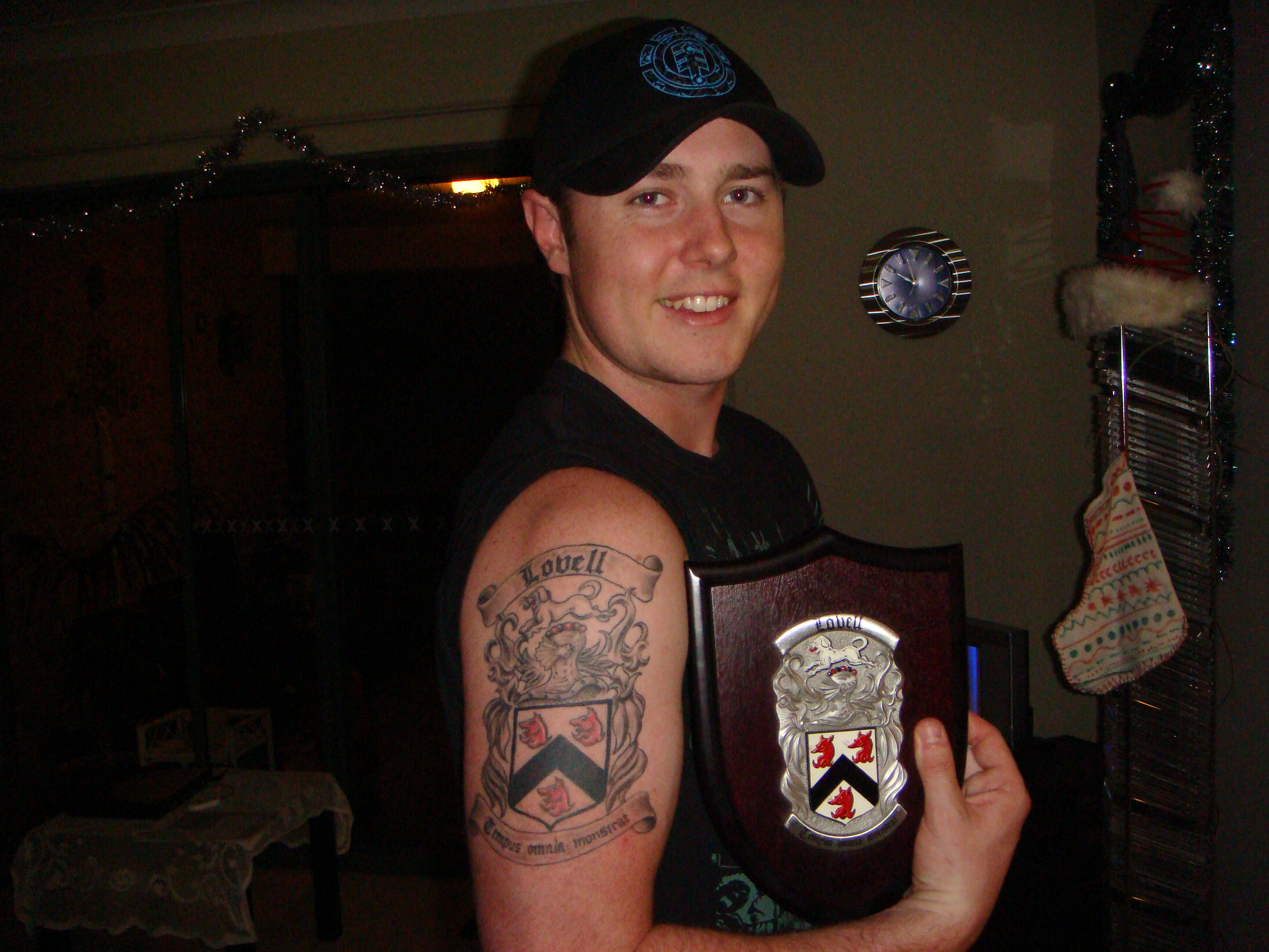 Smiling Guy With Family Crest Shield n Tattoo