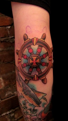Steering Wheel Tattoo On Elbow