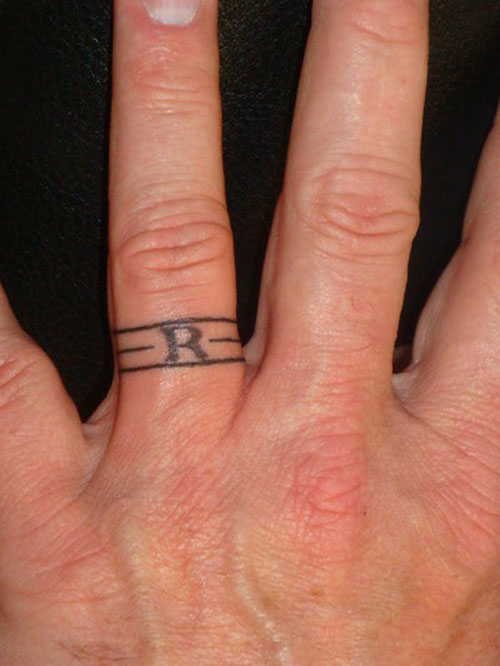 Awesome Wedding Ring Finger Tattoo