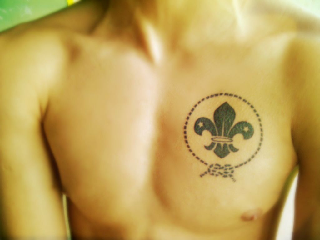 Black Ink Fleur De Lis Tattoo On Chest