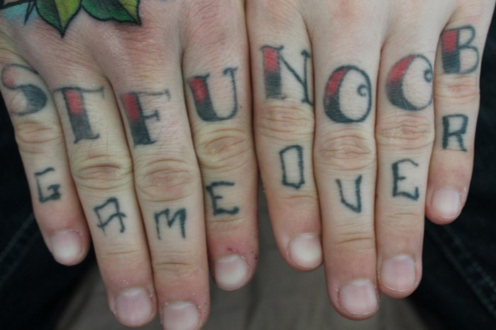 Cool Game Over Lettering Tattoo On Fingers