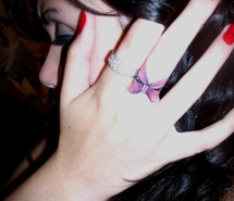 Cute Bow Tattoo On Finger