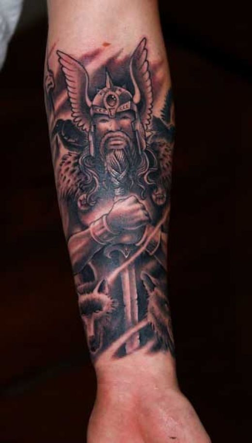 Fantasy Tattoo On Lower Arm