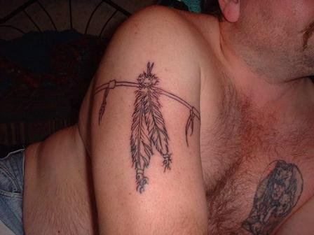 Feather Arm Band Tattoo Design On Biceps