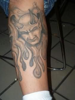 Grey Ink Fire nd Flame Devil Tattoo On Leg