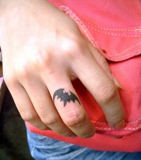 Little Bat Tattoo On Middle Finger