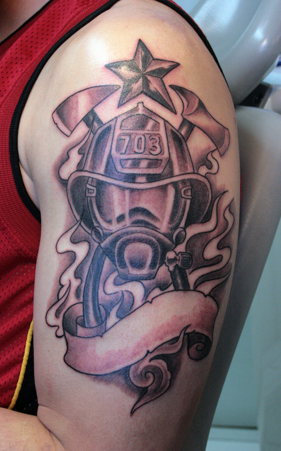 Nice Firefighter Tattoo On Biceps