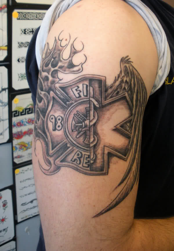 Nice Firefighter Tattoo On Upper Arm