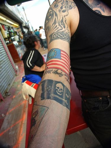 Pirate Flags Tattoo On Arm