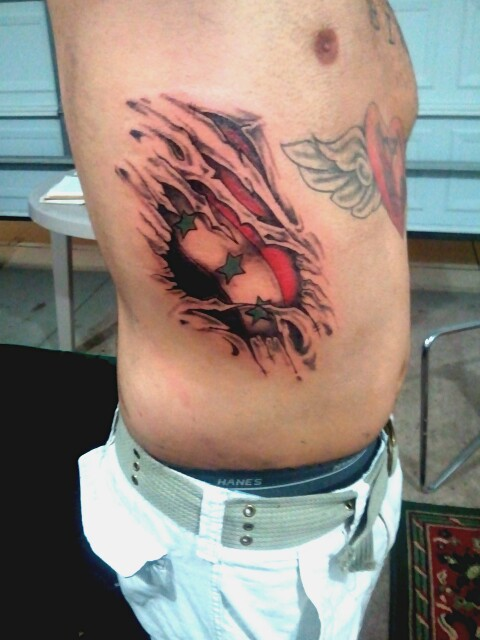 Ripped Skin Flag Tattoo On Rib Side For Men