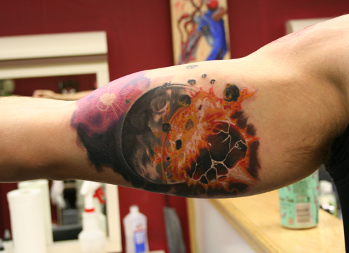 Space Planet Fire Tattoo On Muscles