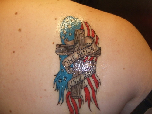 Wooden Cross With US Flag Tattoo On Back Shoulder