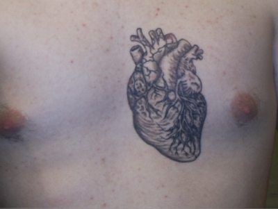 A Human Heart Tattoo On Chest