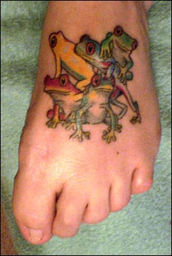 Animated Frogs Tattoo On Foot