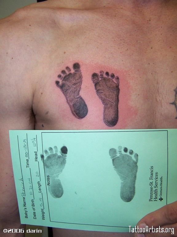 Baby footprints tattoo on chest