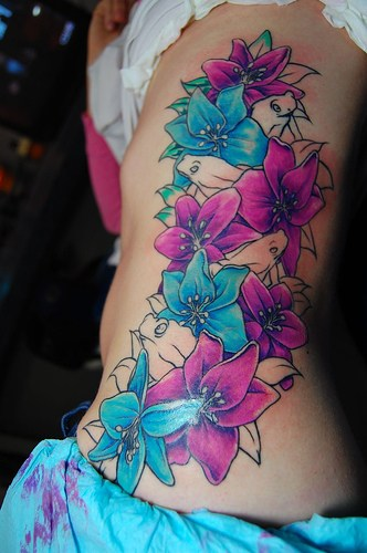 Beautiful Flowers Tattoo On Rib Side